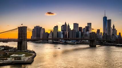 Sunset, dusk and night over the Brooklyn Bridge