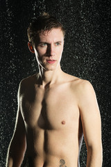Attractive man under water drops. Nude torso