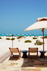 Sunbeds and umbrellas at the beach of luxury hotel, Abu Dhabi, U