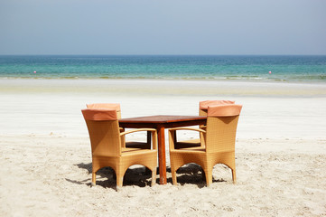 The table and chairs on beach of the luxury hotel, Ajman, UAE