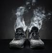 Leinwanddruck Bild - Old work shoes in smoke