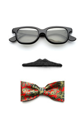 Glasses, mustache and bow-tie forming man face