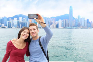 Selfie tourist couple taking picture in Hong Kong
