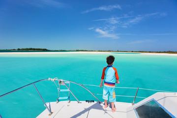 Little boy at luxury yacht