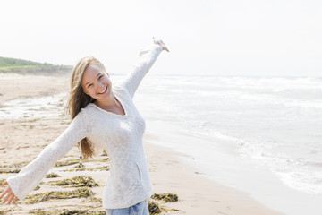 Young woman happy on beach