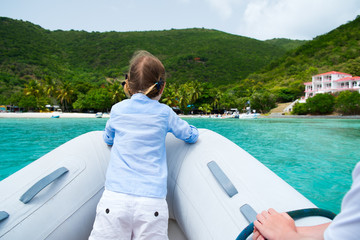 Little girl have a ride on inflatable boat