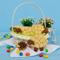 Holiday almond biscuits lamb in a basket. Square