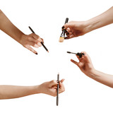 hands ith a makeup brushes and pencils, isolated on white