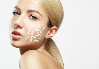 woman with ideal skin and glowing puzzle