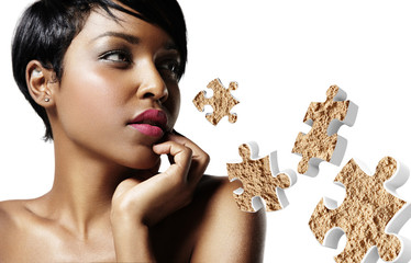 closeup portrait of a black woman with an ideal skin and puzzle
