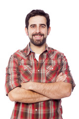 Smiling young casual man with arms crossed, isolated on white ba