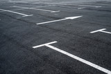 Fototapety Asphalt surface of the parking with road marking lines