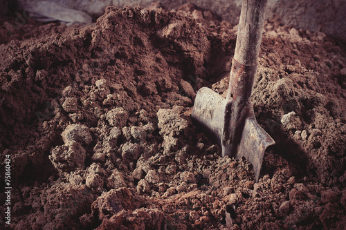 Shovel in sand - 75860424