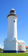 White Lighthouse against Blue Sky