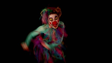 dancing clown with lot of grimaces is having fun