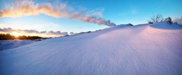 Beautiful winter landscape with sunset sky