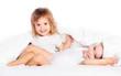 happy little girls twins sister in bed having fun