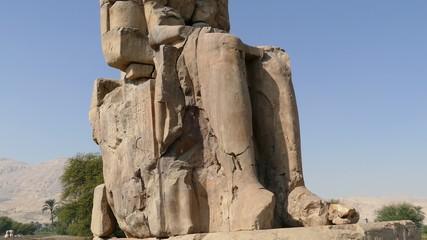 colossi of memnon gigantic statues in Luxor Egypt - tilt view 4k