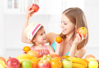 happy family mother and child, eat healthy food,  fruit