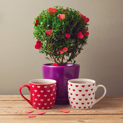 Tea cups and tree plant with heart shapes for Valentine's day