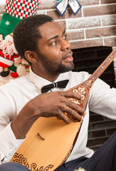 African American man with Musical instrument Dombra