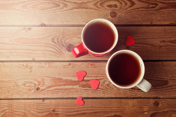 Romantic tea cups with heart shape on wooden table