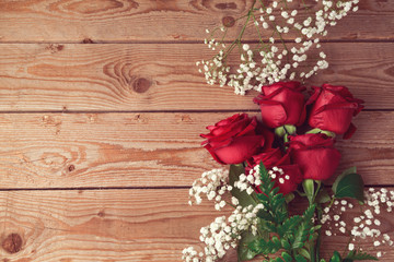 Valentine's day roses background on wooden table