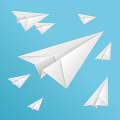 White paper planes on blue sky