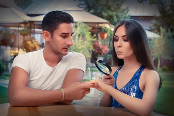 Curious Girl Testing Engagement Ring from Boyfriend