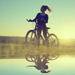 Girl on a bicycle in the sunset