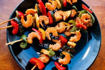 teriyaki shrimps on black plate