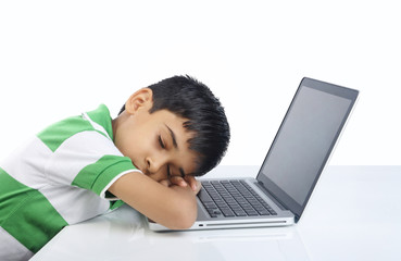 School Boy Sleeping over the laptop