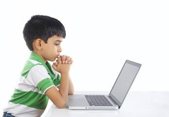 Indian Boy Praying with Laptop