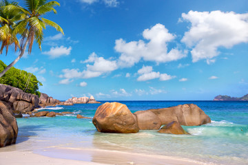 Takamaka beach with granite rocks, Mahe Island, Seychelles