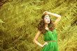 Beautiful young woman in green dress