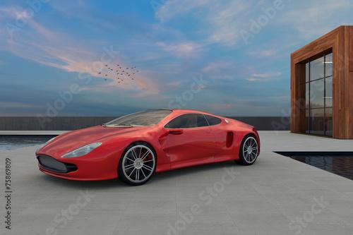 Sportwagen vor blauem Himmel mit modernem Gebäude