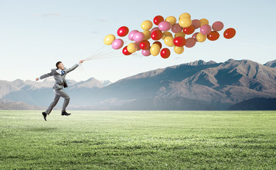 Businessman with balloons