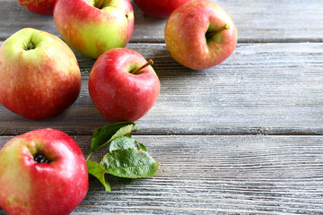 Fresh apples on wooden boards