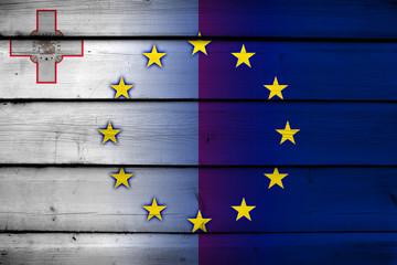 Malta and European Union Flag on wood background