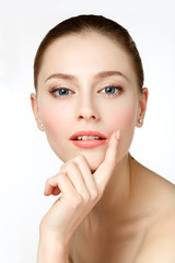 Beauty Portrait. Beautiful Woman Touching her Face. Perfect Fres