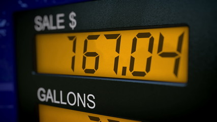 Zoom in on gas pump display with fast rising numbers
