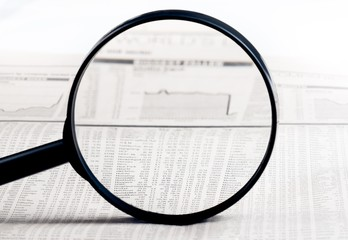 financial data and graph see through loupe