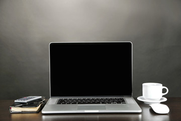 Modern laptop on table, on grey background