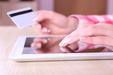 Concept for Internet shopping: hands holding tablet and credit