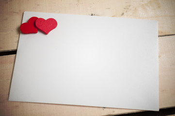 red heart on a white envelope