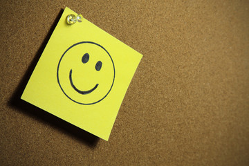 smile on yellow paper