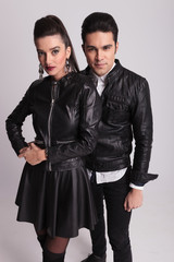 fashion couple posing on grey studio background