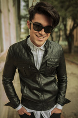 young fashion man smiling to the camera