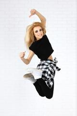 Hip hop dancer dancing on wall background
