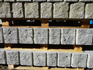 Rough blocks of granite in a yard